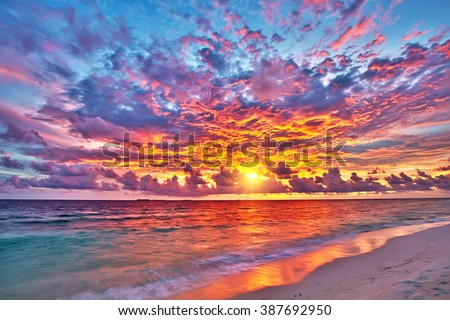 Colorful sunset over ocean on Maldives #387692950