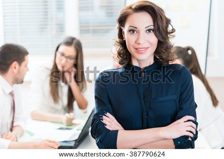 Manager with her team working in the office #387790624