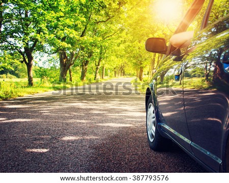 Car on asphalt road in summer #387793576