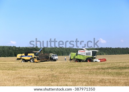 Tatarstan, Russia - August 15 2015: Hot Harvest in the vast fields of Tatarstan on a sunny summer day. #387971350