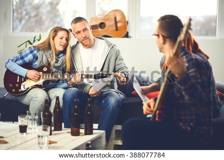 Home band learning new song together #388077784