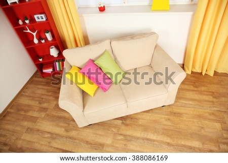 Modern living room interior with beige  sofa and small green carpet #388086169