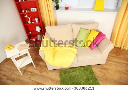 Modern living room interior with beige sofa and small green carpet #388086211