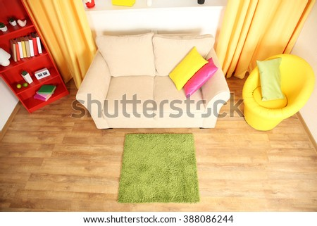 Modern living room interior with white sofa and green carpet #388086244