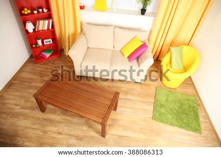 Modern living room interior with beige  sofa, wooden coffee table and yellow chair #388086313