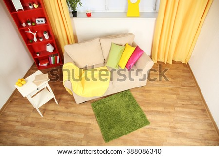 Modern living room interior with beige sofa and small green carpet #388086340