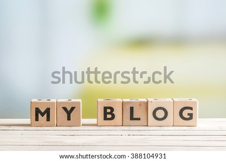 Personal blog sign on a wooden indoor table #388104931