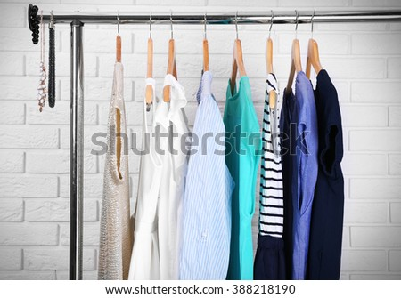 Collection of female clothes hanging on a rack #388218190