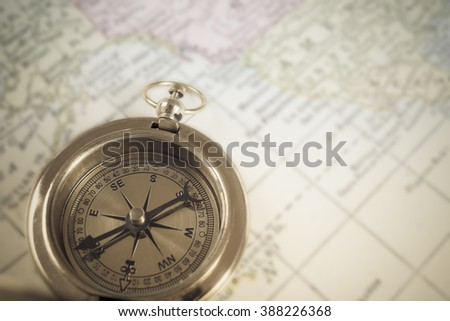 Compass on map background, use for travel concept #388226368
