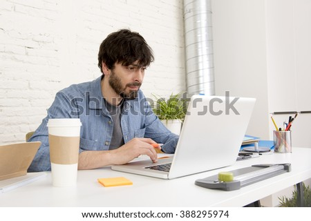 corporate portrait of young hispanic attractive hipster businessman on his 30s working at modern home office with computer laptop in creative freelancer and self employed business model  #388295974