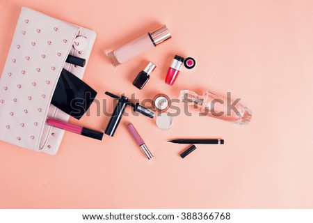 Make up bag with cosmetics isolated on pink background Royalty-Free Stock Photo #388366768