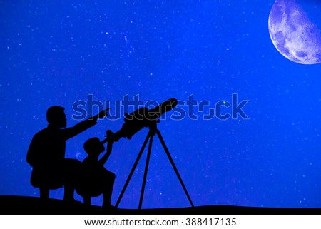 Silhouette of father and son looking moon through a telescope at beautiful night sky #388417135