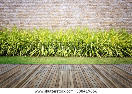 Wooden decking and plant with wall garden decorative #388419856
