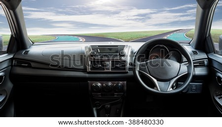 Car dashboard speeds while on road curve and sky background #388480330