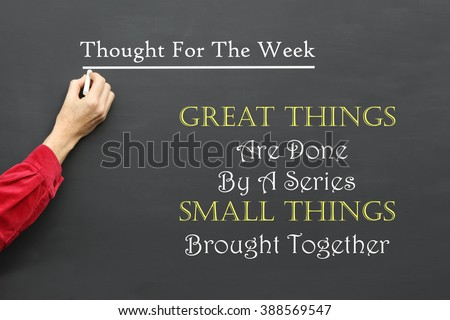 Inspirational Thought For The Day message of Great Things Are Done By A Series Of Small Things Brought Together written on a School Blackboard by the teacher #388569547