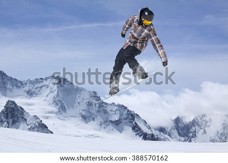 Snowboard jump on mountains. Extreme sport. #388570162