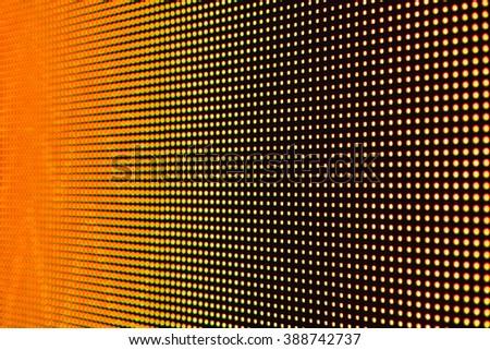 MACRO VIEW OF ORANGE LED SCREEN DISPLAY WITH LOW DEPTH OF FIELD