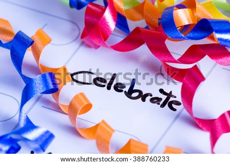 concept image for celebrating life using a dry erase calendar and curly ribbon