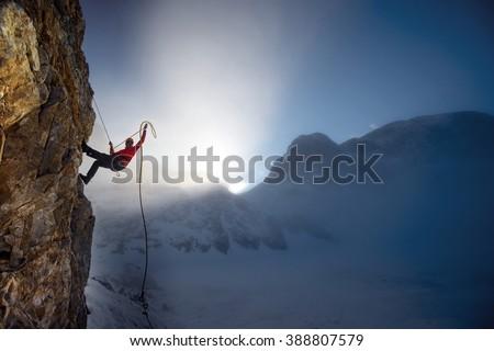 extreme winter climbing Royalty-Free Stock Photo #388807579