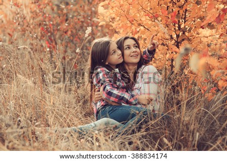 happy mother and daughter on the walk on summer field. Family spending vacation outdoor, lifestyle capture., cozy mood