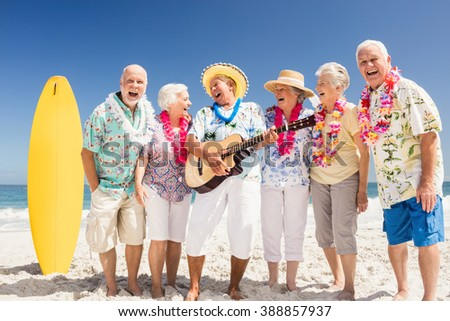 Portrait of smiling senior friends on the beach #388857937