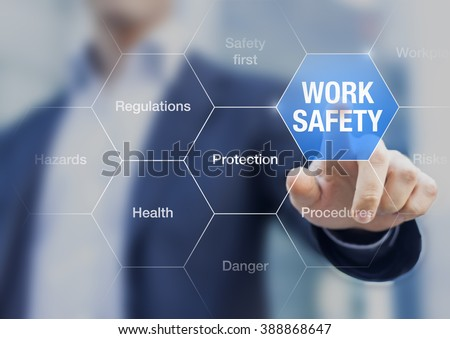 Businessman presenting work safety concept, hazards, protections, health and regulations Royalty-Free Stock Photo #388868647