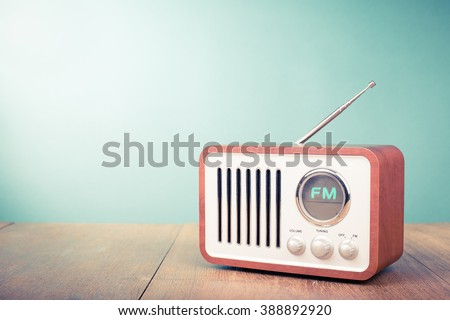 Retro old radio front mint green background. Vintage style filtered photo #388892920