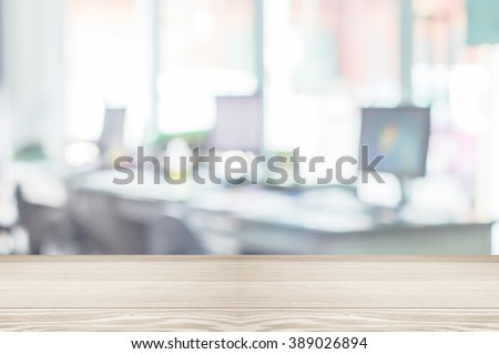 Businessmen blur in the workplace or work space of table work in office with computer or shallow depth of focus of abstract background.