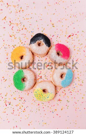 Assorted donuts on a pastel pink background, copyspace #389124127