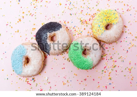 Colorful vibrant donuts with sugar sprinkles #389124184