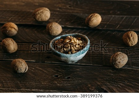 walnuts on a brown table, walnuts in pottery #389199376