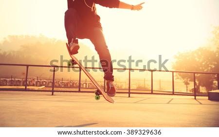 skateboarding woman legs at skatepark #389329636