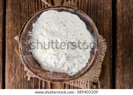 Portion of Milk Powder (selective focus) on an old wooden table #389403109