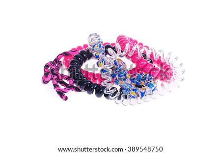 lots of colorful elastic bands for hair on a white background #389548750