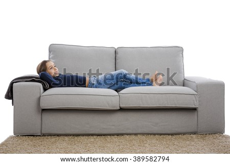 Little girl lying on a couch and resting #389582794