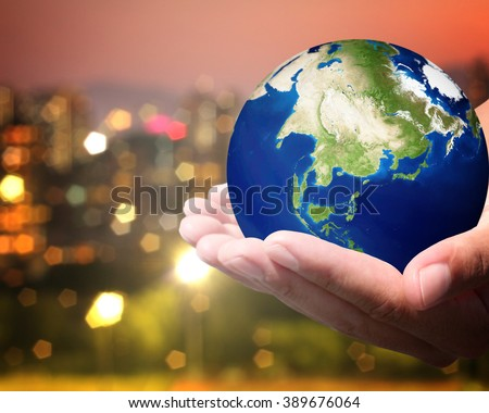 The world is on hold for the city bokeh blur background. Elements of this image furnished by NASA. #389676064