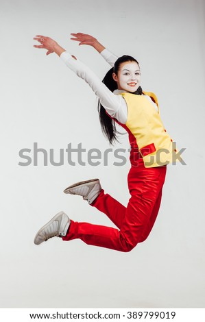 studio shot of two mimes jumping isolated on a white background #389799019