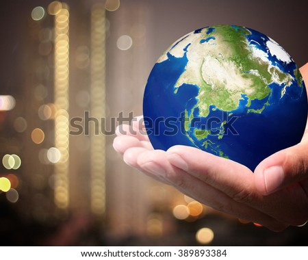 The world is on hold for the city bokeh blur background. earth social in human the hand. Businessman holding planet Earth in palm. Elements of this image furnished by NASA. #389893384