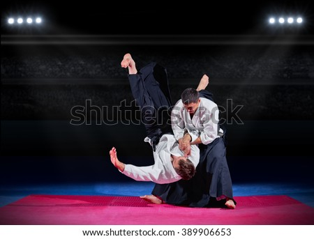Fight between two aikido fighters at sport hall Royalty-Free Stock Photo #389906653