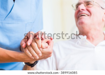Nurse holding hand of senior man in rest home #389916085