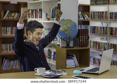 Happy winner. success businessman or students celebrating scream #389917144