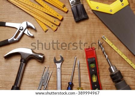Assorted work tools on wood #389994967
