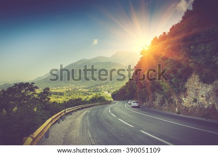 View of the road bend and a mountain range near Budva, Montenegro. Balkans, Adriatic sea, Europe.  #390051109