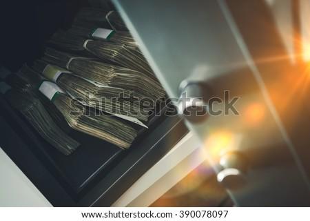 Cash Money Safe Deposit. Small Residential Vault with Pile of Cash Money. Closeup Photo. #390078097