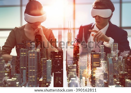 two business persons are developing a project using virtual reality goggles. the concept of technologies of the future Royalty-Free Stock Photo #390162811