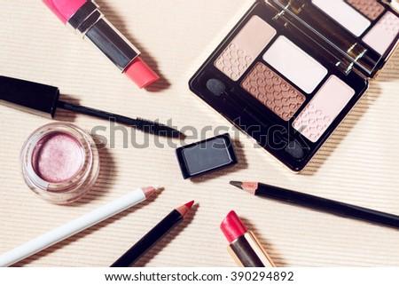 Makeup set of beige, brown, pink eyeshadows, eye pencil, lip pencil, lipstick and mascara #390294892
