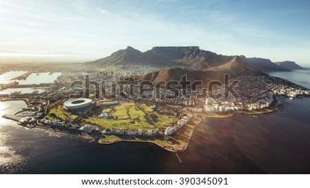 Aerial view of Cape Town with Cape Town Stadium, Lion's Head and Table mountain. Royalty-Free Stock Photo #390345091