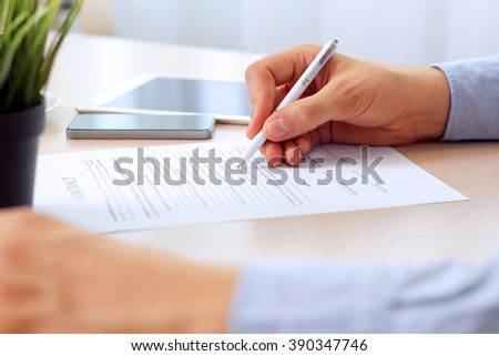 Businessman is signing a contract, business contract details #390347746