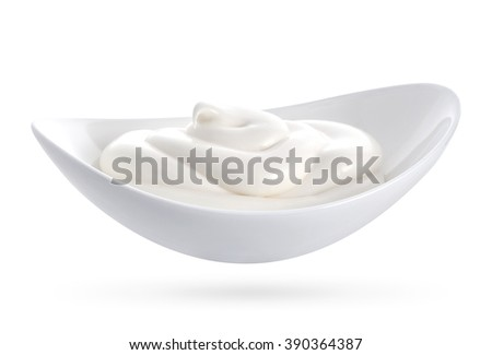 Bowl of sour cream on white wooden table #390364387