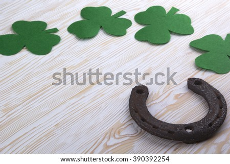 Fabric green clover leaves with horseshoe on wooden background.  #390392254
